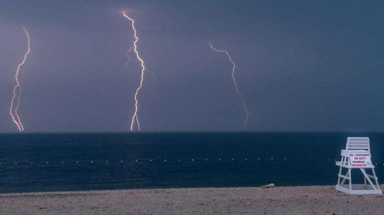 Lightning is seen from Iron Pier Beach in