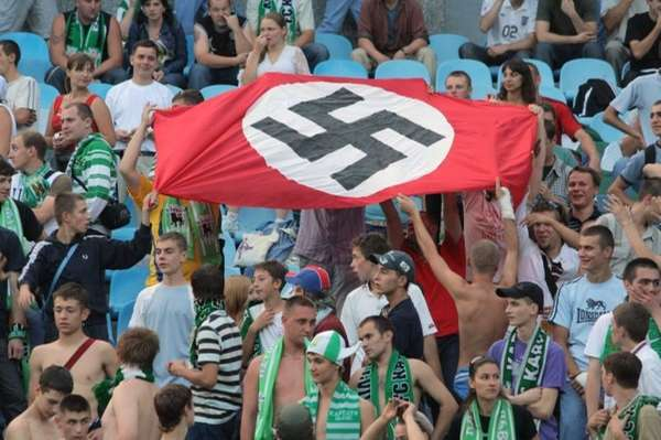 Soccer fans show a German Nazi flag with