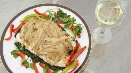 Striped bass over spinach with sauteed onions and