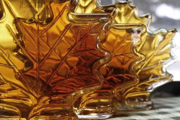 These are bottles of maple syrup seen on