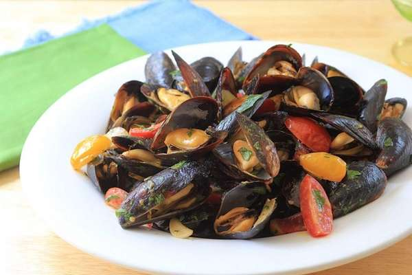 Mussels are grilled and tossed with sauteed garlic