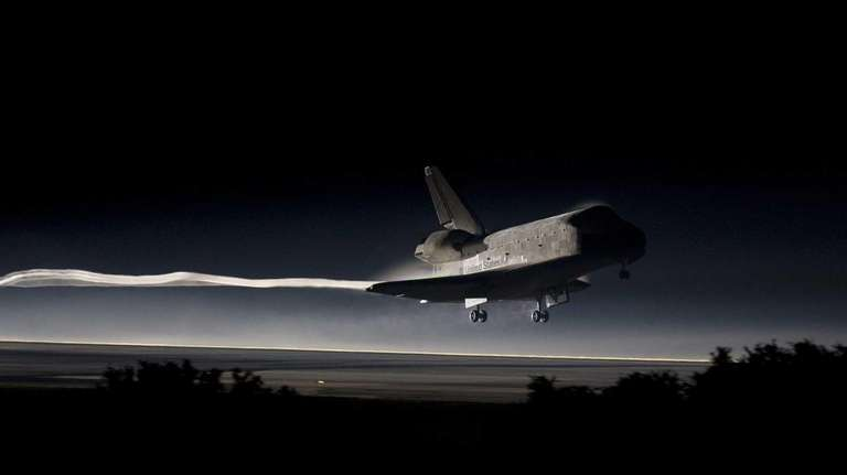 The space shuttle Atlantis lands on July 21,