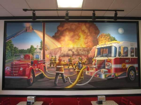 Murals depicting firefighters in action decorate the walls