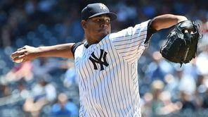 New York Yankees starting pitcher Ivan Nova delivers