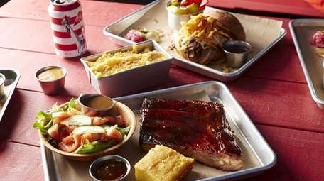St. Louis ribs are served with salad, cornbread,
