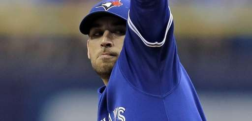 Toronto Blue Jays pitcher Marco Estrada winds up