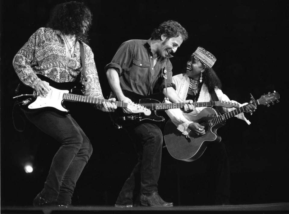 Bruce Springsteen, center, performs with Shane Fontayne, left,