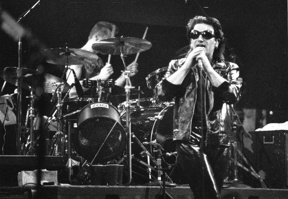 Lead singer Bono performs with U2 at the