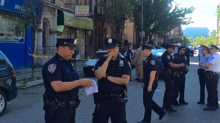Police officers in front of a bodega in