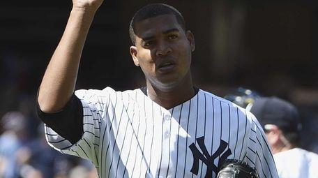 New York Yankees starting pitcher Ivan Nova tips