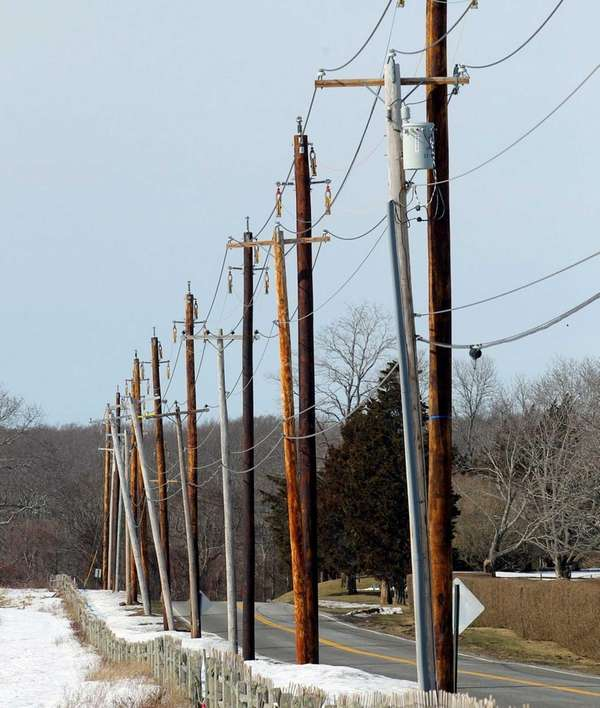 Utility poles line Old Stone Highway in Amagansett