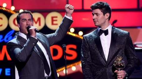 Host Rob Riggle and Carey Price of the