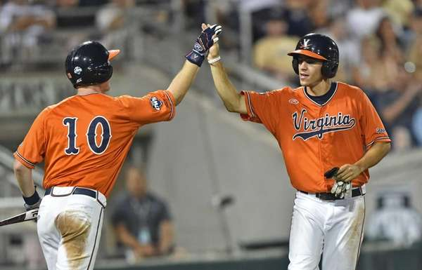 Adam Haseley, right, of the Virginia Cavaliers celebrates