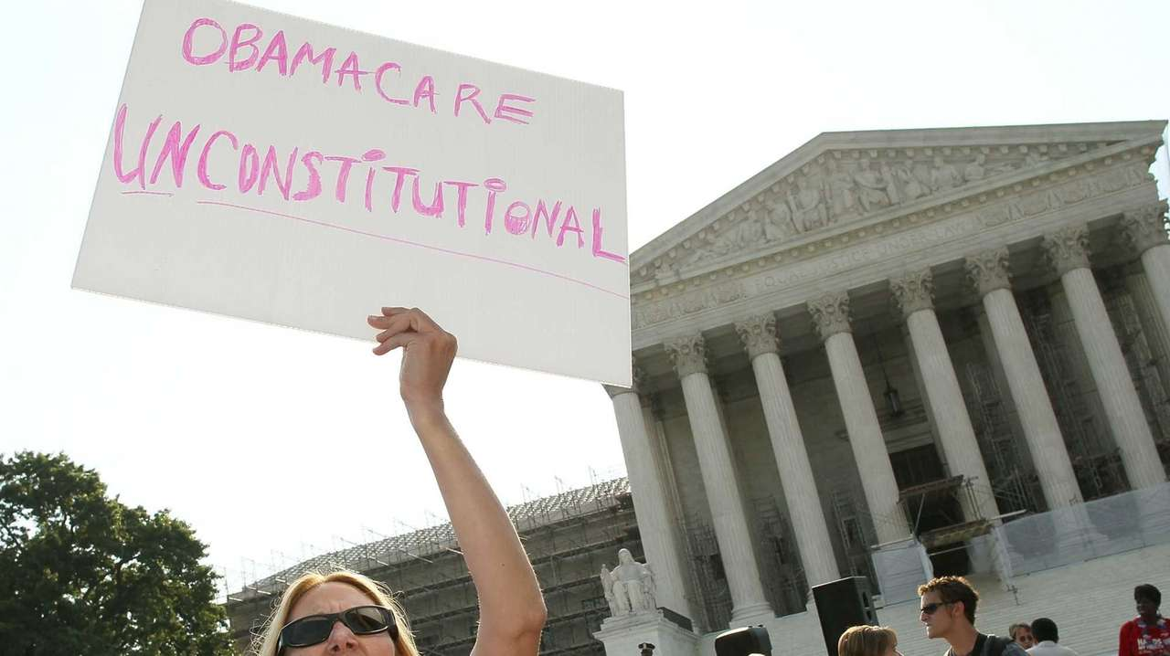 An Obamacare protester at the Supreme Court in