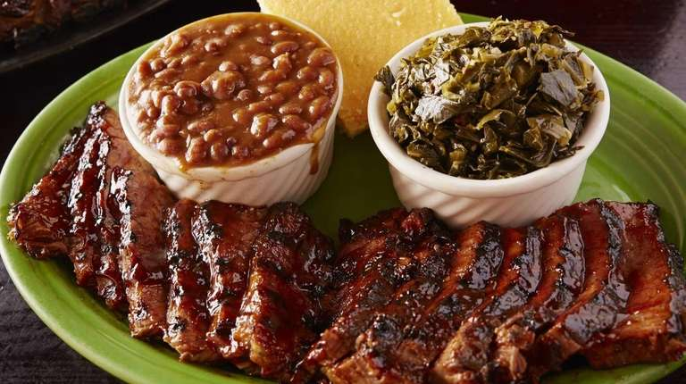Sliced smoked brisket is served with sides of