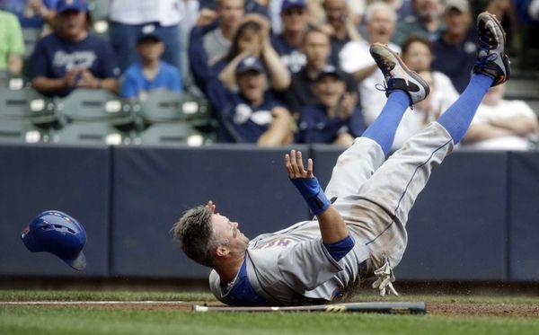 The New York Mets' Michael Cuddyer loses his