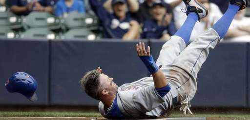 The New York Mets' Michael Cuddyer loses his