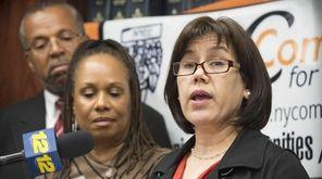 Hempstead school board member Maribel Touré right, with