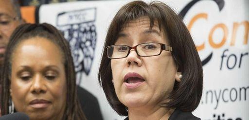 Hempstead school board member Maribel Touré, right, with