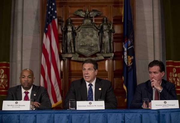 New York Gov. Andrew M. Cuomo, center, speaks