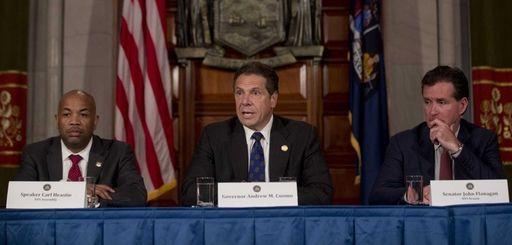 New York Gov. Andrew M. Cuomo, center, speaks
