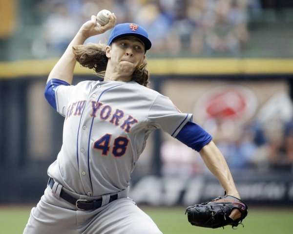 Mets starting pitcher Jacob deGrom throws during the