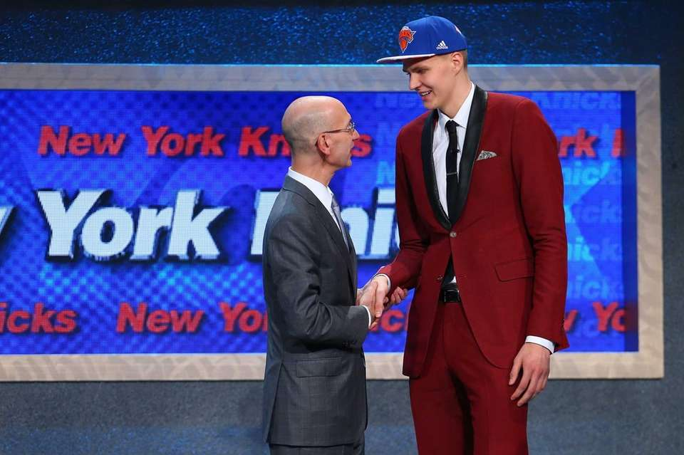Kristaps Porzingis of Latvia shakes hands with NBA