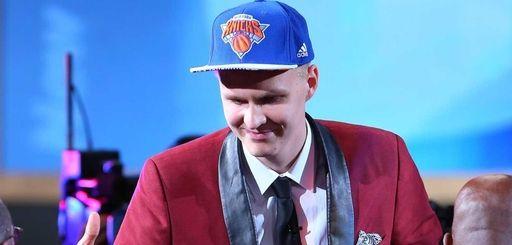 Kristaps Porzingis of Latvia celebrates after being drafted
