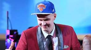 Kristaps Porzingis of Latvia celebrates after being drafted