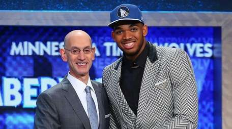 Karl-Anthony Towns of Kentucky shakes hands with NBA