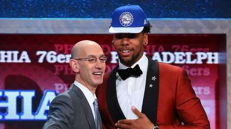 Jahlil Okafor of Duke shakes hands with NBA
