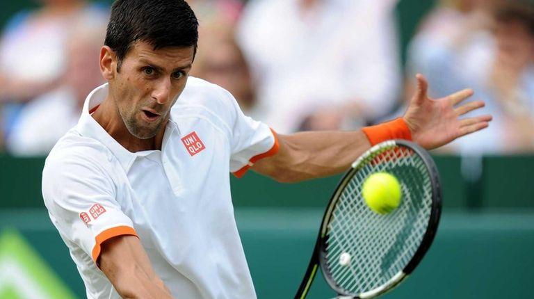 Serbia's Novak Djokovic in action against France's Richard