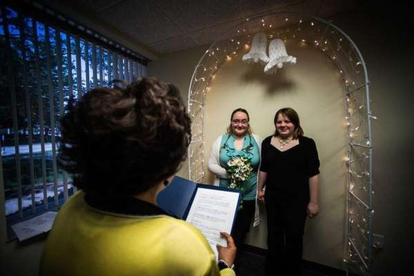 Nancy Waters peforms the ceremony for Lori Hazelton