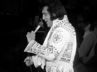 Elvis Presley performs at the Nassau Veterans Memorial