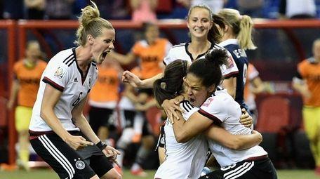 Celia Sasic of Germany celebrates with teammates as
