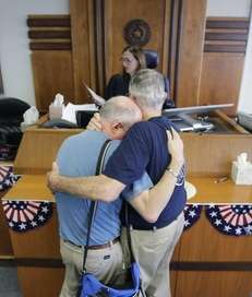 Gerald Gafford, right, comforts his partner of 28
