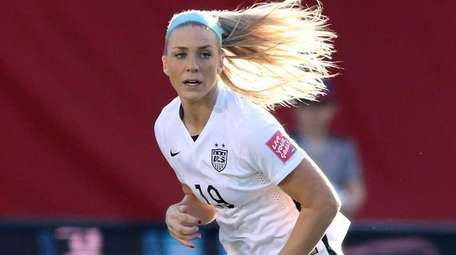 Julie Johnston of the United States controls the