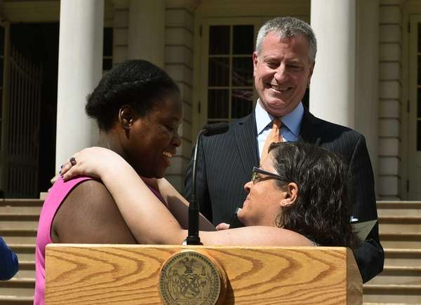 New York City Mayor Bill de Blasio officiates