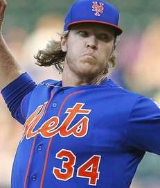 Noah Syndergaard of the New York Mets pitches
