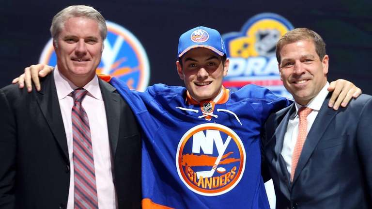 Mathew Barzal poses after being selected 16th overall