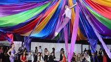 An acrobat performs a high-flying routine during the