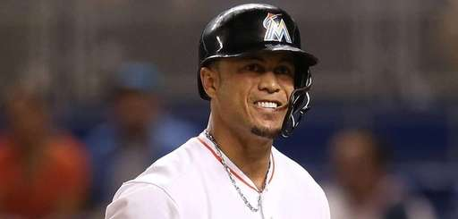 Giancarlo Stanton of the Miami Marlins winces after
