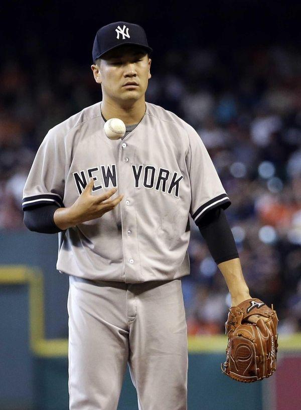 Yankees starting pitcher Masahiro Tanaka waits to throw