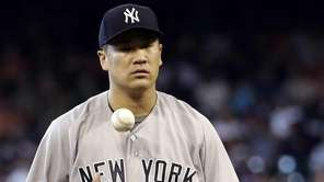 Yankees starting pitcher Masahiro Tanaka waits to throw