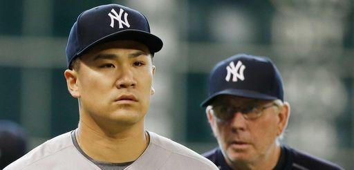 Masahiro Tanaka of the New York Yankees walks