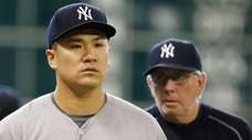 Masahiro Tanaka of the New York Yankees walks