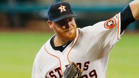 Brett Oberholtzer of the Houston Astros throws a