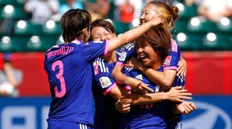 Mana Iwabuchi of Japan celebrates scoring a goal
