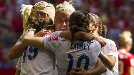 Steph Houghton of England celebrates with teammates after