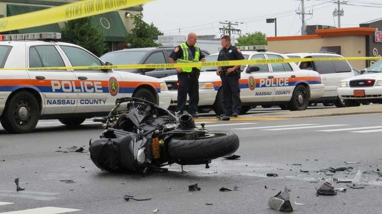 The wreckage of a motorcycle rests in the